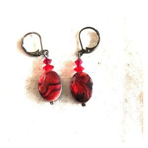 Two pairs of earring. Gunmetal and glass red beads